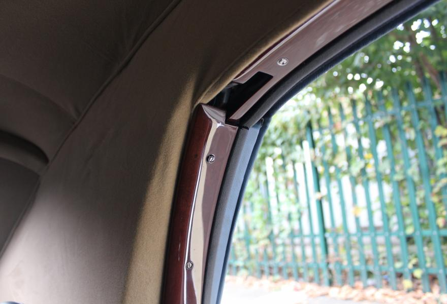 wooden trim around windows of a silver cloud 2 rolls-royce